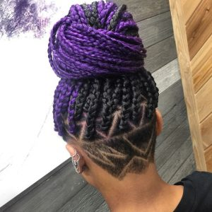 half purple box braids with shaved design