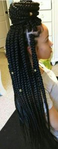 half up half down dookie braids with beads