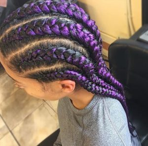 purple streaked feed in braids